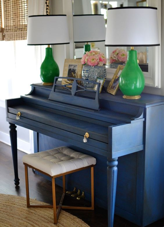 a vintage piano painted classic blue and accented with crystal knobs will add a vintage yet trendy touch