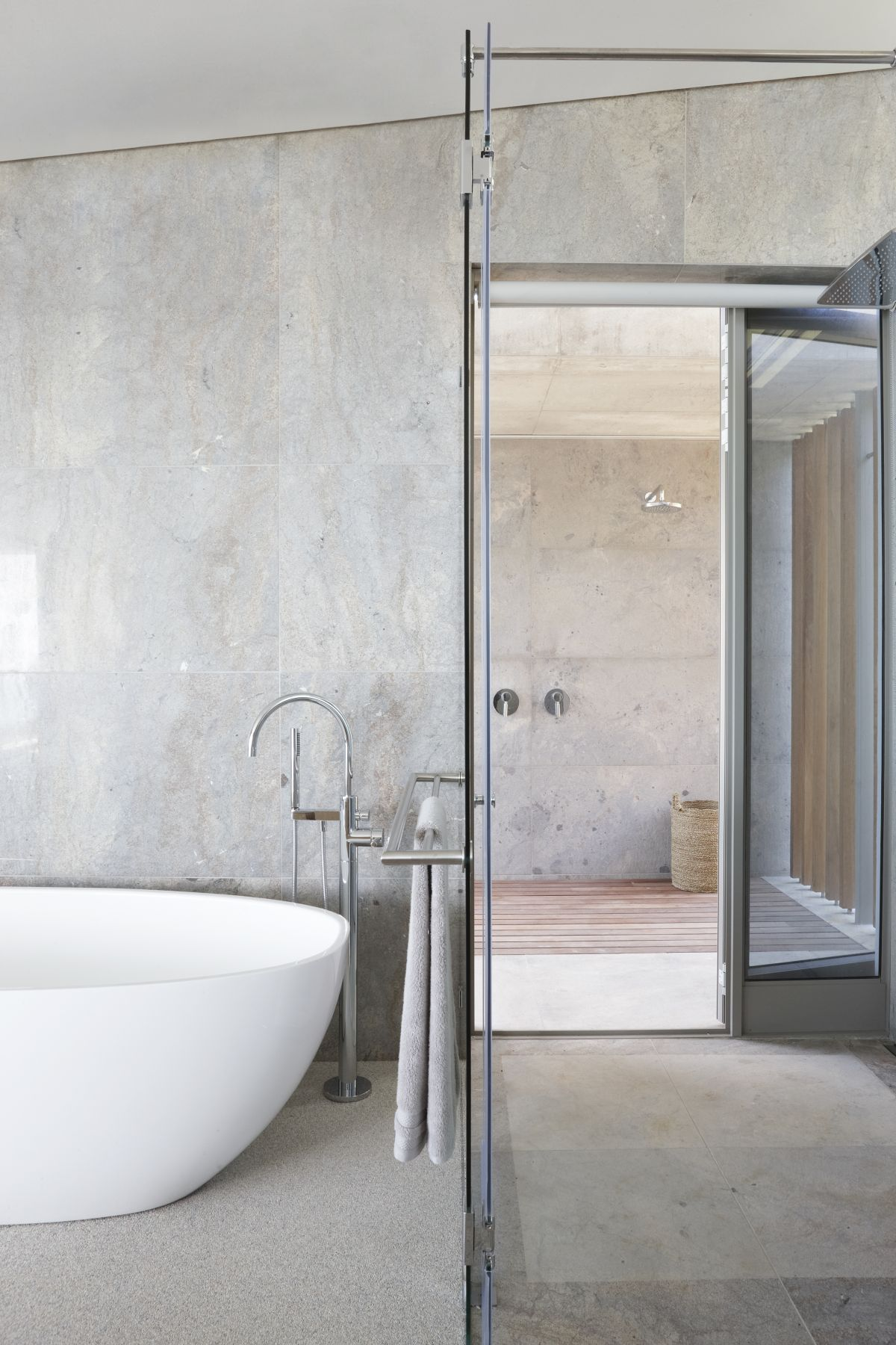 The bathroom is also here, with a shower space and clad with grey tiles