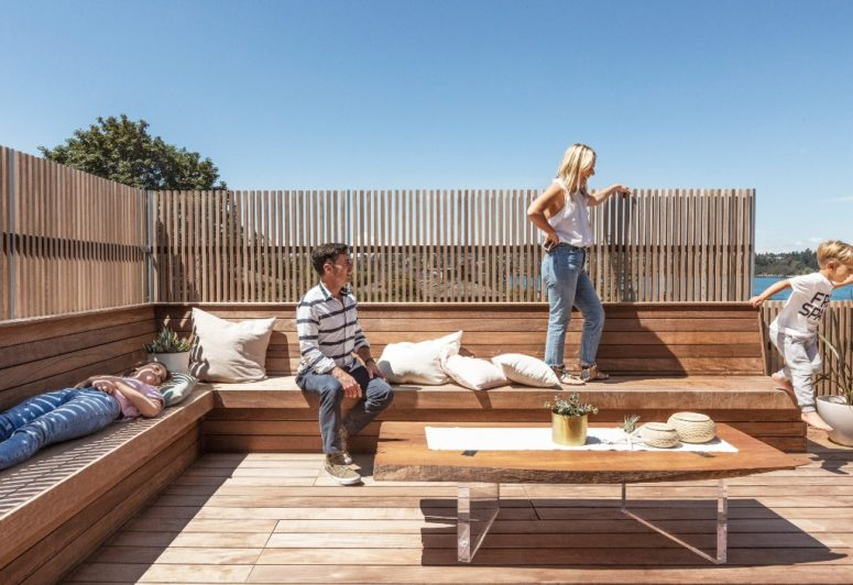 an outdoor deck with a corner bench