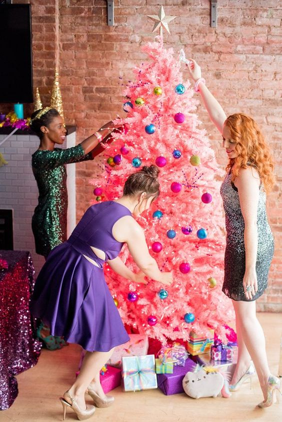 a bold pink Christmas tree with colorful ornaments and a star topper plus lights is awesome for a girls' party