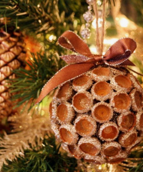 a glitter acorn Christmas ornament with a matching bow is a fun and very natural idea of a winter decoration