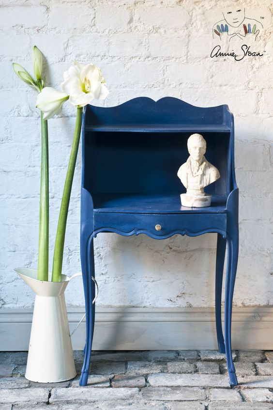 a vintage furniture piece painted classic blue is a chic and refined idea that will make your space trendy