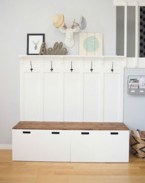 an IKEA mudroom bench with storage made of IKEA STUVA benches and Svartsjon hooks plus a wooden seat for a contrasting touch