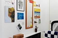 07 a black IKEA Trones with a white countertop for a small entryway and colorful decor around to create a contrast