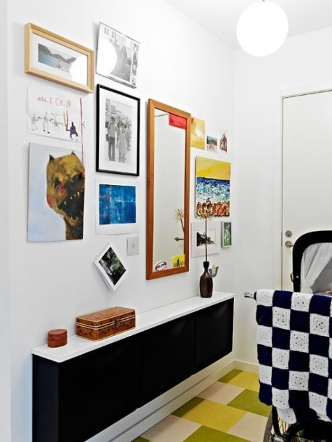 a black IKEA Trones with a white countertop for a small entryway and colorful decor around to create a contrast