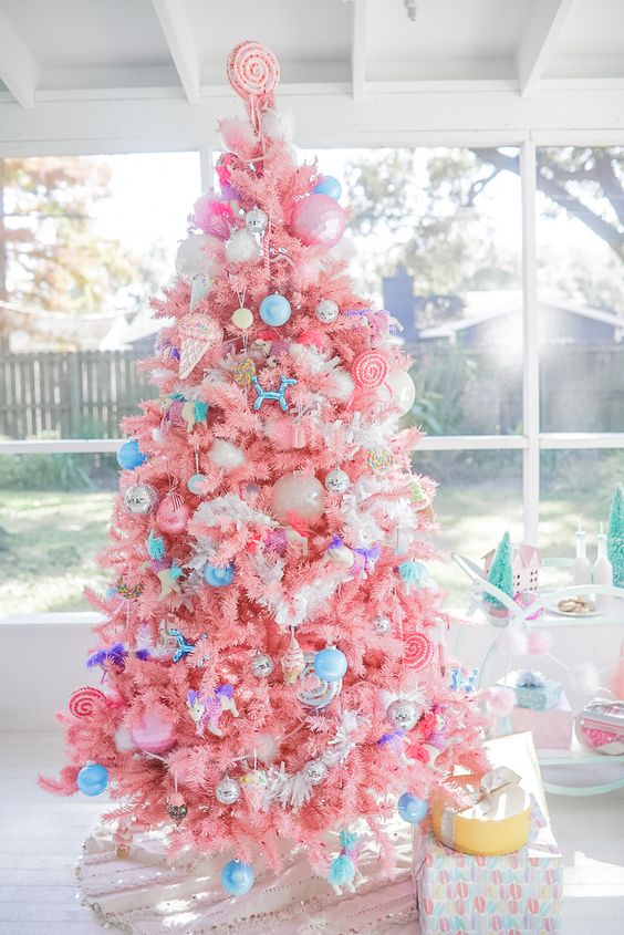a bright candy-colored Christmas tree with bold blue ornaments, ice cream and popsicle ornaments and a candy topper