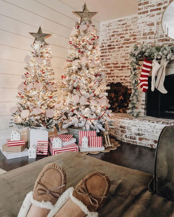 a duo of flocked Christmas trees with lights, star toppers, paper buntings makes a holiday statement