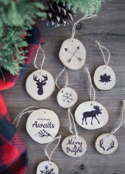 a variety of wood slice Christmas ornaments with images done in black paint can be made by you with stumps or you can paint
