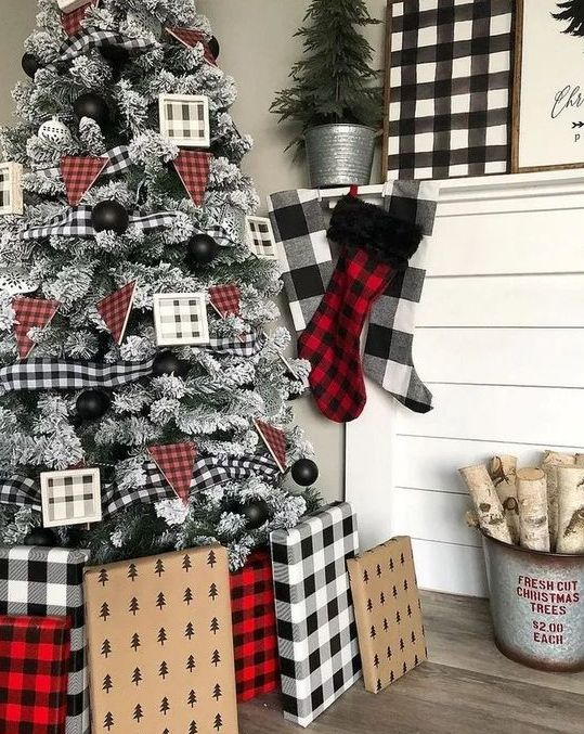 buffalo check ornaments, buntings and ribbons, stockings, an artwork and gifts wrapped into buffalo check and plaid
