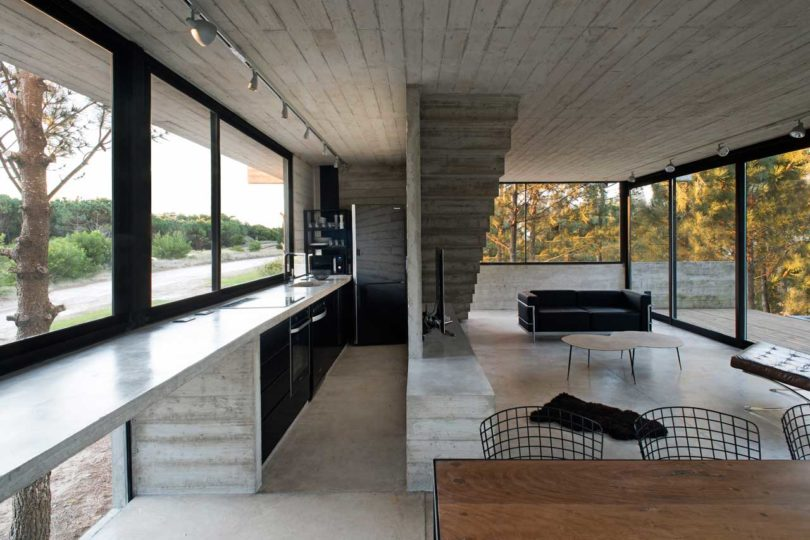 The kitchen is long and narrow, with built in furniture and appliances plus a window instead of a backsplash