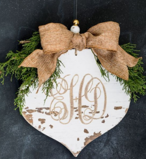 a white plywood Christmas ornament with evergreens, a burlap bow and monograms plus beads is a cool vintage idea
