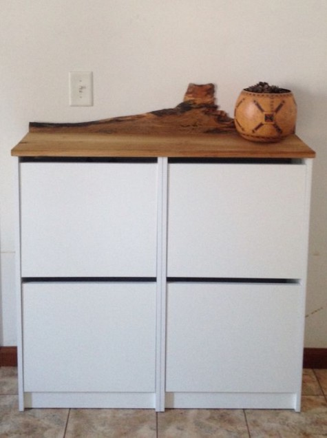 an IKEA Bissa hack with a wooden living edge countertop is an edgy idea as live edges are on top right now