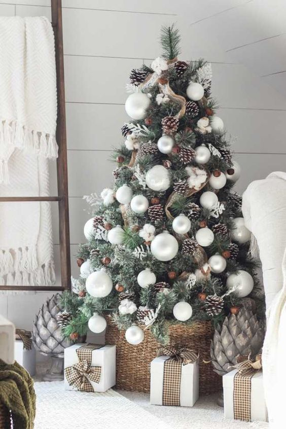 a cozy farmhouse Christmas tree with burlap mesh ribbons, snowy pinecones, pearly ornaments and cotton plus a basket