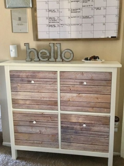 a cozy rustic IKEA Hemnes shoe storage piece done with weathered wooden planks, which can be substituted with some tape