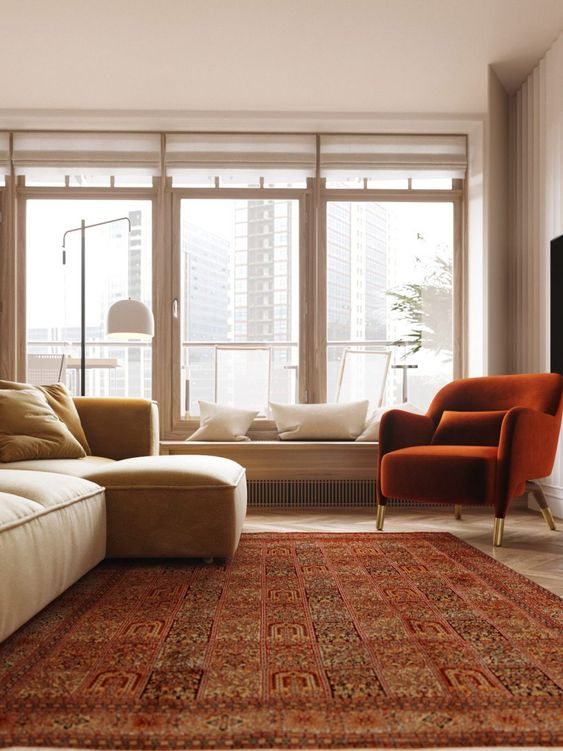 a welcoming and inviting warm-toned living room with a reddish carpet and a chair plus a yellow sofa and neutrals