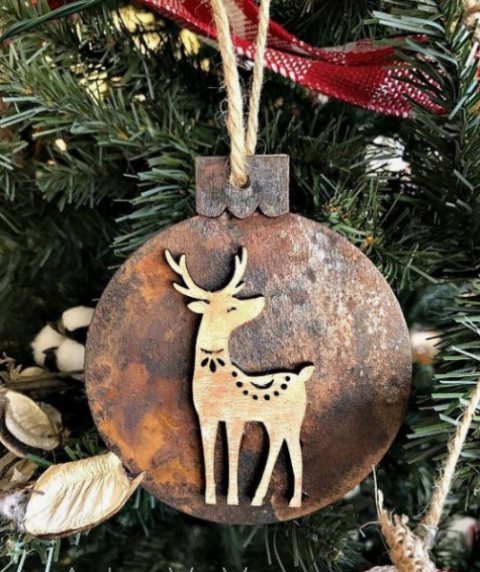 a wooden Christmas ornament with rust decor and a little wooden deer on it is super cute and nice
