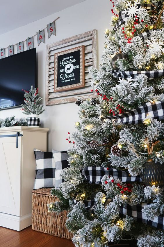 buffalo check pillows and a garland on the tree will give your space a cozy Christmas farmhouse feel