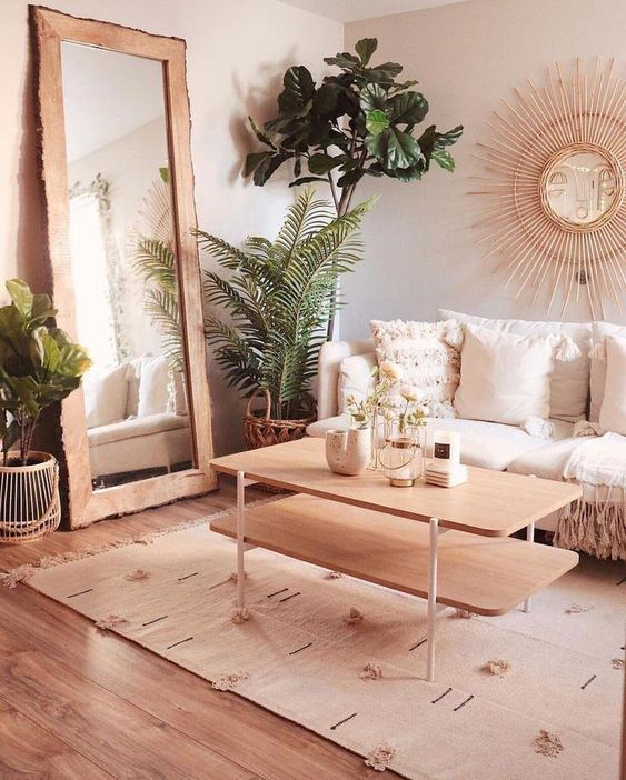 a super welcoming and cozy warm neutral living room with light-colored wood and lots of greenery in pots