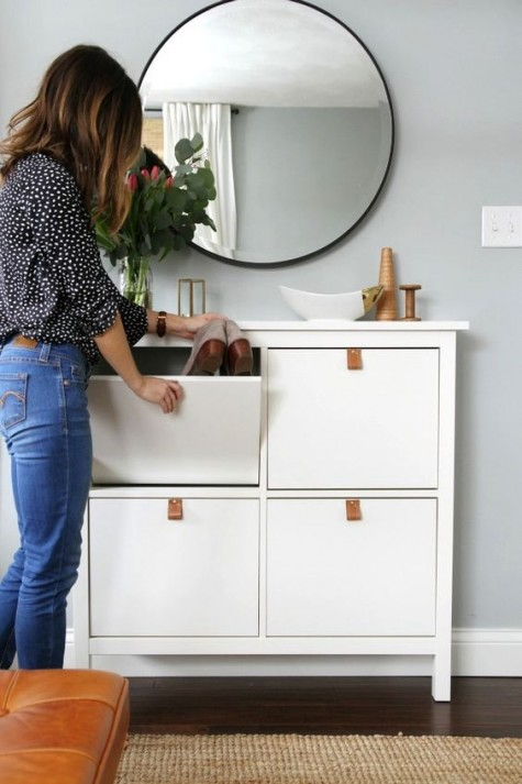 a chic and simple IKEA Hemnes cabinet hack with leather pulls is a cool way to spruce up a simple storage piece