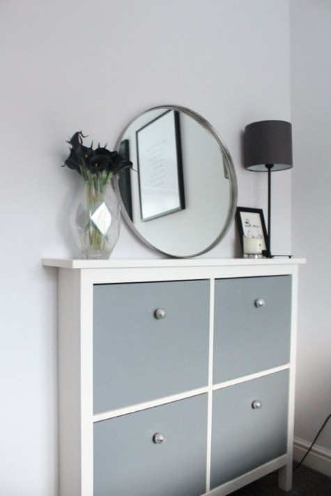 a grey IKEA Hemnes hack with mercury glass knobs for a contemporary entryway with lack of space