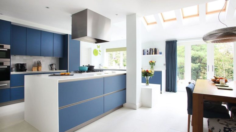 a minimalist classic blue kitchen and matching curtains will add color and chic to your space