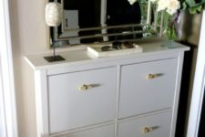 12 a white Hemnes shoe storage piece with new handles that bring a fresh look and a new feel