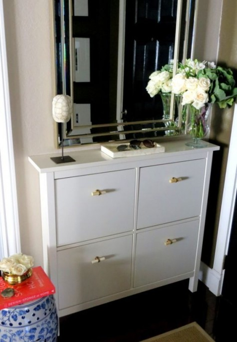 a white Hemnes shoe storage piece with new handles that bring a fresh look and a new feel