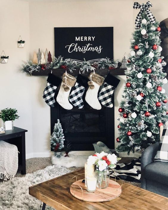 buffalo check and white stockings with faux fur, buffalo check bows and fake trees for Christmas