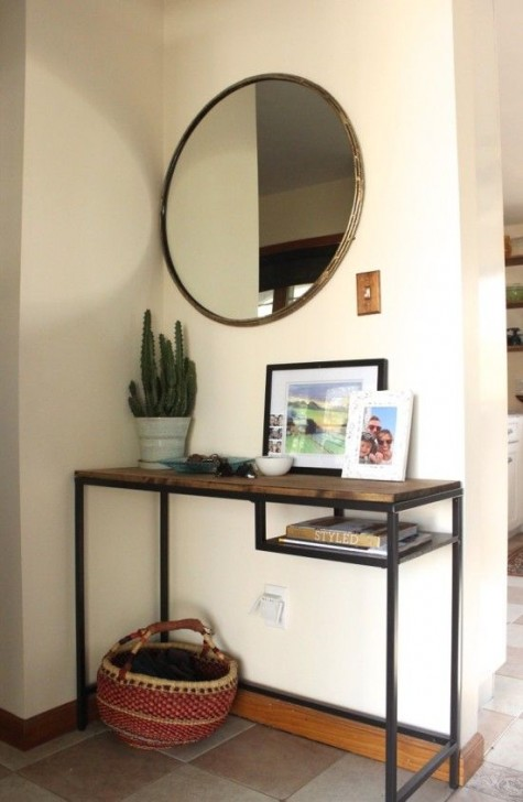 a simple and stylish entryway console of an IKEA Vittsjo desk that got a wooden tabletop for a more rustic look