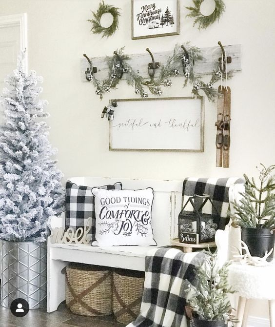 buffalo check pillows and a blanket for adding a cozy vintage Christmas feel to your entryway