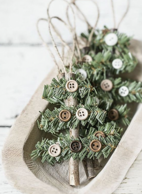 rustic Christmas ornaments made of sticks, evergreens, buttons and twine are easy and cool for any Christmas tree