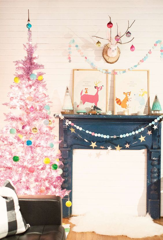 a hot pink tinsel Christmas tree with lights and colorful ornaments is a bright touch for your holiday space