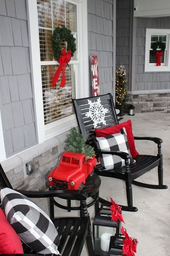 buffalo check pillows and red touches make this front porch vintage and very Christmas-like