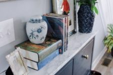 16 a navy IKEA Hemnes shoe cabinet with navy paint and some marble contact paper plus brass knobs to get a stylish look