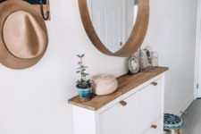16 a sleek entryway console table of an IKEA Hemnes cabinet with a wooden top and leather pulls