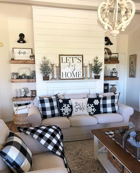 buffalo check pillows, a table runner and a blanket are stylish farmhouse-inspired accessories for a cozy feel