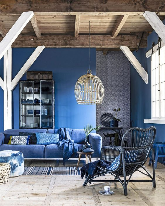 a beautiful classic blue living room with walls and a sofa plus grey touches for a chic and cool look