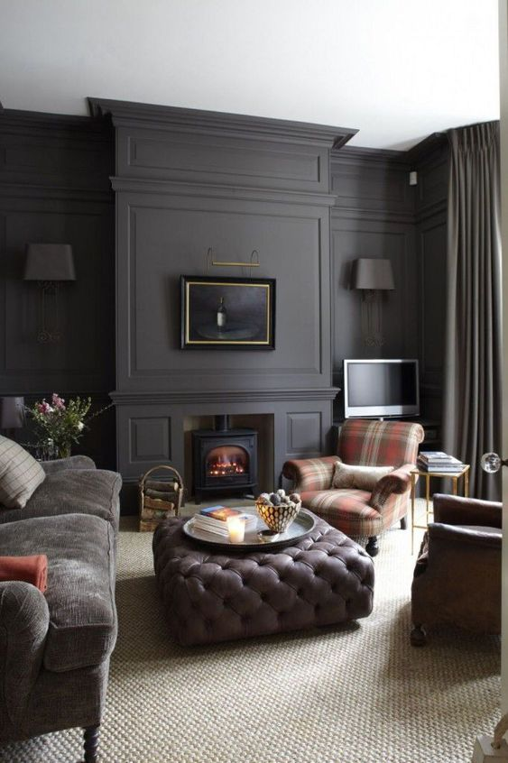 a moody living room with graphite grey walls and muted and subdued tones everywhere else