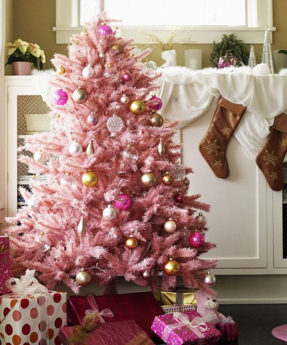 a pastel pink Christmas tree with sheer, gold and pink ornaments with a vintage feel looks very sophisticated