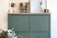 17 a sleek green entryway console of an IKEA Hemnes shoe cabinet and brass knobs plus a wooden tabletop for a more chic look