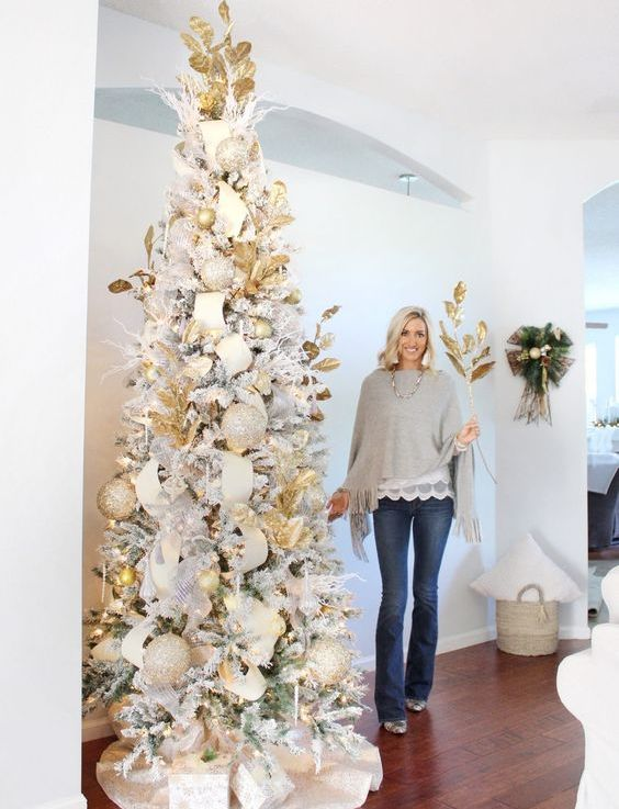 a southern glam Christmas tree with usual and oversized metallic and glitter Christmas ornaments and lights plus gilded leaves