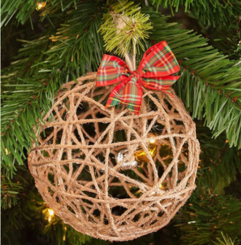 a yarn Christmas ball ornament with bells inside and a red plaid bow on top is a pretty and whimsy idea