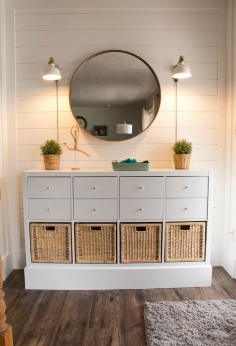 an elegant rustic console table of an IKEA Kallax unit and some basket drawers will rpovide you with a lot of storage space