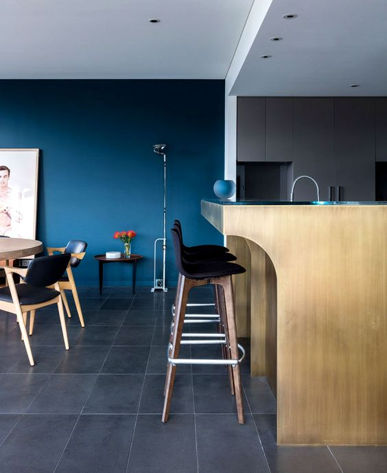 a contemporary space with an accent classic blue wall that brings a mood and color to the layout