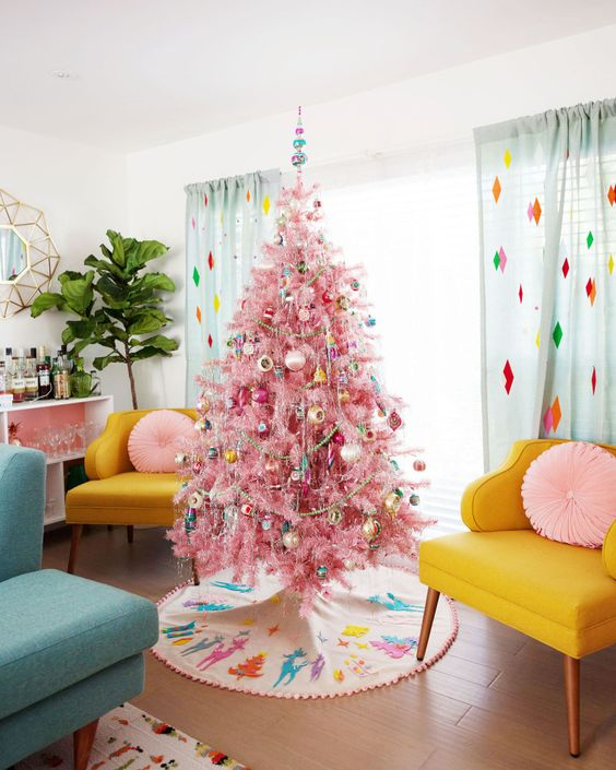 a pink Christmas tree with colorful retro ornaments, garlands and bead garlands adds even more color