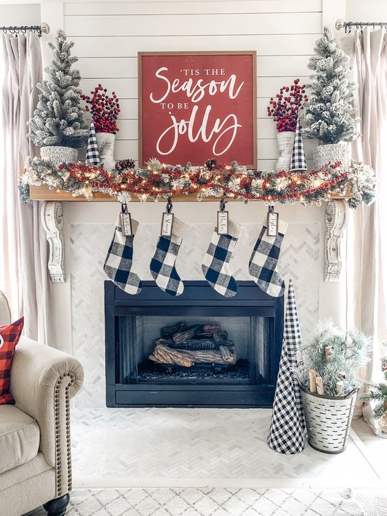 buffalo check stockins and some faux Christmas trees to make your space ultimately farmhouse-like