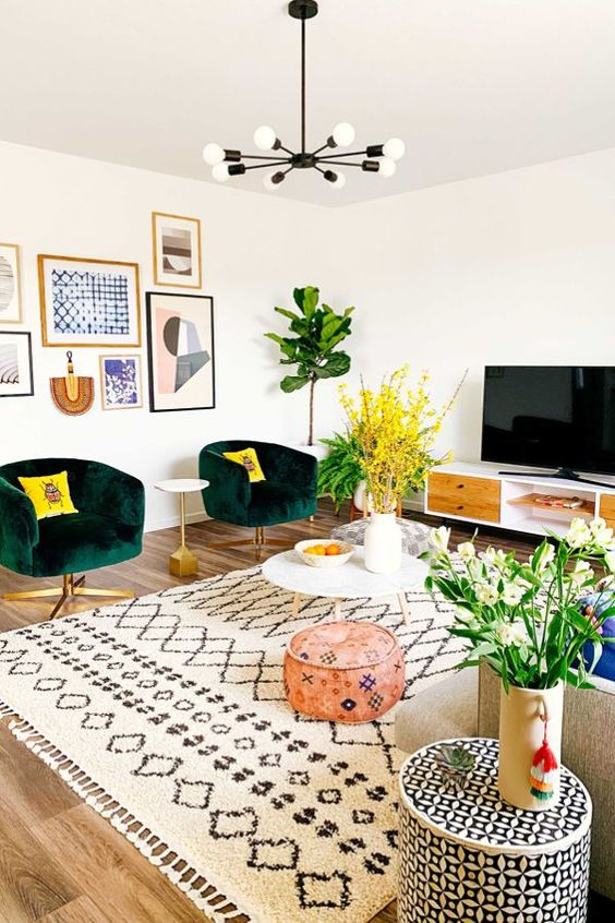 a neutral living room spruced up with bright and colorful furniture, accessories and artworks