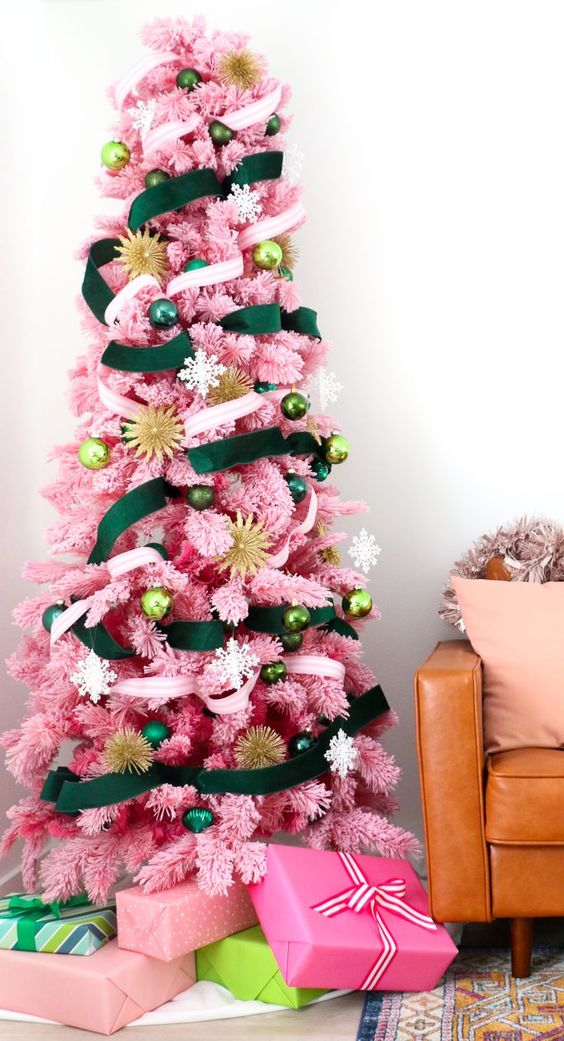 a pink Christmas tree with emerald and neutral ribbons and ornaments in various shades of green plus gold touches