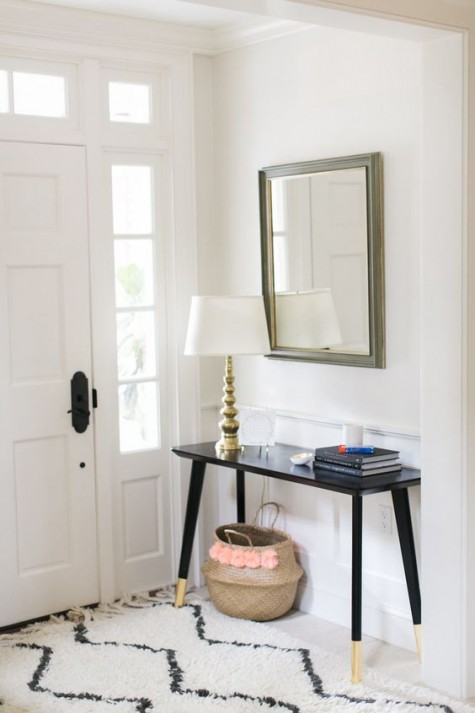 an IKEA Lisabo desk hacked into a stylish entryway console with just some gold paint on the legs