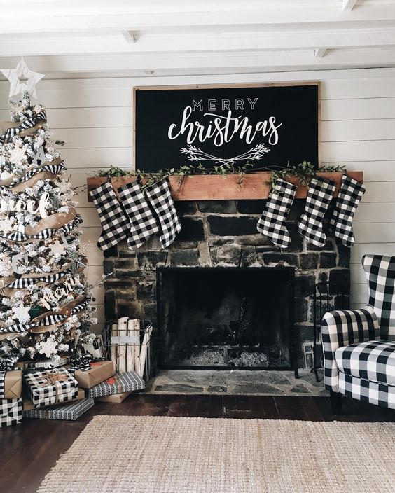 buffalo check stockings, a chair, a ribbon on the tree and gift boxes to make the space look vintage and Christmassy
